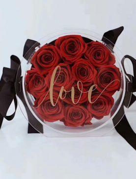 Rosas preservadas en caja acrílica redonda